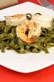 Spinach fettuccine with prawns Royalty Free Stock Image