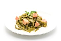 Spinach fettuccine with salmon. Isolated on white background royalty free stock photos
