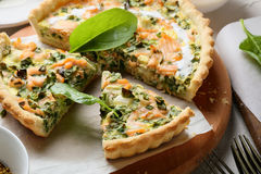 Spinach and fish quiche royalty free stock photography
