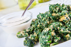 Spinach fried with egg Stock Images