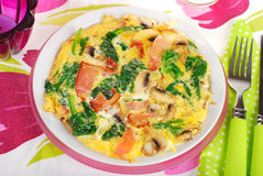 Spinach frittata with mushroom,ham and dried tomato Stock Images