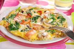 Spinach frittata with mushroom,ham and dried tomato Stock Photos