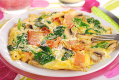 Spinach frittata with mushroom,ham and dried tomato Stock Photo