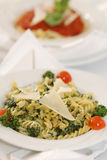 Spinach fussili. Pasta fussili with spinach and sauce of white wine and cheese Stock Photo