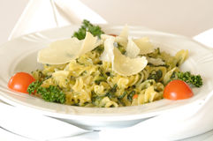 Spinach fussili. Pasta fussili with spinach and sauce of white wine and cheese Royalty Free Stock Image