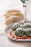 Spinach gnocchies. With tomato sauce and parmesan cheese Royalty Free Stock Images