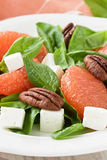 Spinach grapefruit goat cheese salad with pecan nut Stock Photo