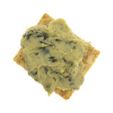 Spinach hommus on whole grain cracker top view Stock Photos