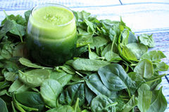 Spinach juice and spinach leafs Stock Photography