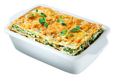 Spinach lasagna isolated. Clipping path. Italian cuisine. Spinach lasagna with basil. isolated on white. With clipping path Royalty Free Stock Image