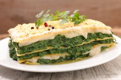 Spinach lasagne. With cream and cheese Royalty Free Stock Images