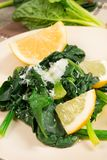 Spinach with lemon Royalty Free Stock Photography