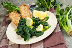 Spinach with lemon Stock Photography