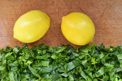 Spinach and lemons Royalty Free Stock Images