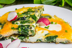 Spinach Omelette with Radish on a White Plate. Detail on a Spinach Omelette with Radish on a White Plate Royalty Free Stock Photography