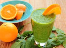 Spinach and orange smoothie Stock Image