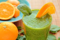 Spinach and orange smoothie in a glass Stock Image