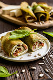 Spinach pancakes stuffed with Feta, curd, sun dried tomato and sunflower seeds Stock Images