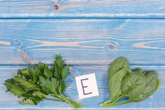 Spinach and parsley containing vitamin E, minerals and dietary fiber, healthy nutrition. Spinach and parsley containing vitamin E, natural minerals and dietary stock photos