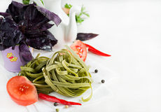 Spinach pasta with tomatoes, herbs and spices Royalty Free Stock Image