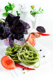 Spinach pasta with tomatoes, herbs and spices Royalty Free Stock Photography