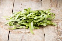 Spinach pasta. Stock Photos