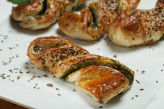 Spinach pastry. Fresh spinach pastry with sesame seeds and cumin seeds on white plate Stock Photo