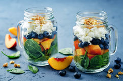 Spinach peach blueberry goat cheese walnuts salad in a jar Royalty Free Stock Photography