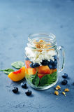 Spinach peach blueberry goat cheese walnuts salad in a jar Royalty Free Stock Photos