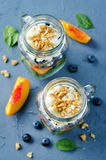 Spinach peach blueberry goat cheese walnuts salad in a jar Stock Image