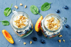 Spinach peach blueberry goat cheese walnuts salad in a jar Stock Photography