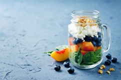 Spinach peach blueberry goat cheese walnuts salad in a jar Royalty Free Stock Image