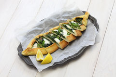 Spinach pide, turkish pizza Stock Photos