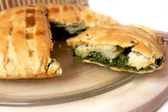 Spinach pie. A slice of delicious homemade spinach pie Royalty Free Stock Photos