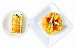Spinach pie and fruity pie on white plate Stock Photo