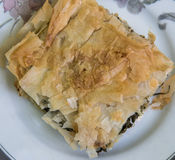 Spinach Pie. Greek dish of spinach pie on a plate Royalty Free Stock Photography