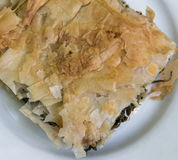 Spinach Pie. A piece of spinach pie on a white plate Royalty Free Stock Images