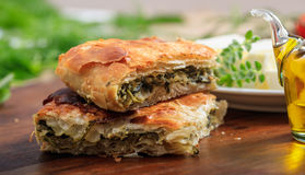 Spinach pie pieces on a table Royalty Free Stock Photo
