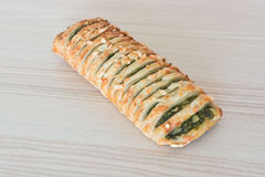 Spinach pie on the wood background Royalty Free Stock Photography