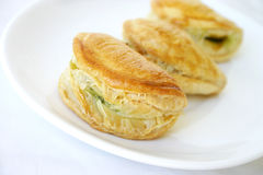 Spinach pies. Close-up of three small spinach pies Royalty Free Stock Images