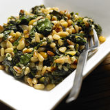 Spinach with pine nuts Stock Photo