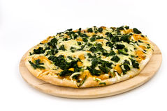 A spinach pizza with mozzarella cheese,spices royalty free stock image