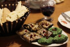 Georgian food: spinach pkhali and aubergines. Spinach pkhali and aubergines with nuts decorated with pomegranate seeds are the traditional vegetarian georgian royalty free stock images