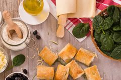 Spinach puffs with feta cheese. stock photos