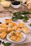 Spinach puffs with feta cheese. stock photography