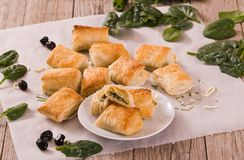 Spinach puffs with feta cheese. stock images