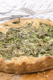 Spinach quiche on a wooden board Stock Photography