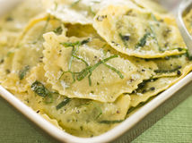 Spinach and Ricotta Ravioli and Sage Butter Stock Photo