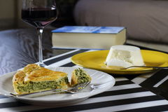 Spinach and ricotta savory pie with a glass of Chianti Stock Photo