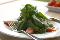 Spinach Salad. Shallow DOF stock photography